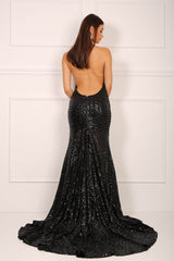 Backless design of black sequinned mermaid evening gown with halter v plunge neck and high centre front leg slit