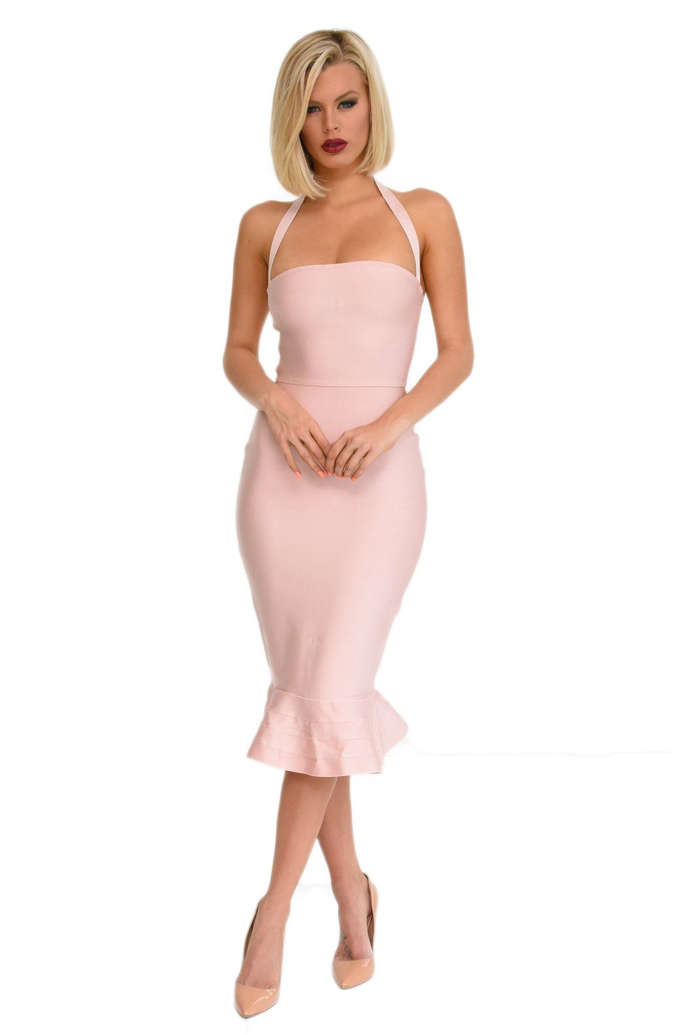 Front shot of blush pink calf length sleeveless bandage dress with halter-neck strap and peplum fluted hem design