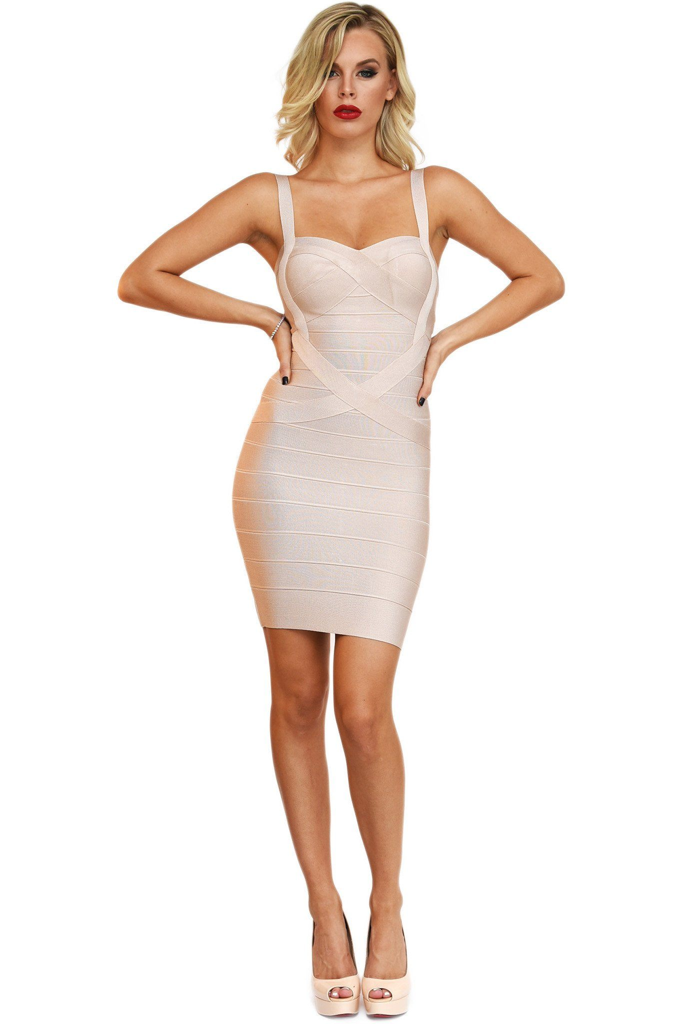 Front of nude colored mini bodycon bandage dress with shoulder straps and sweetheart neckline