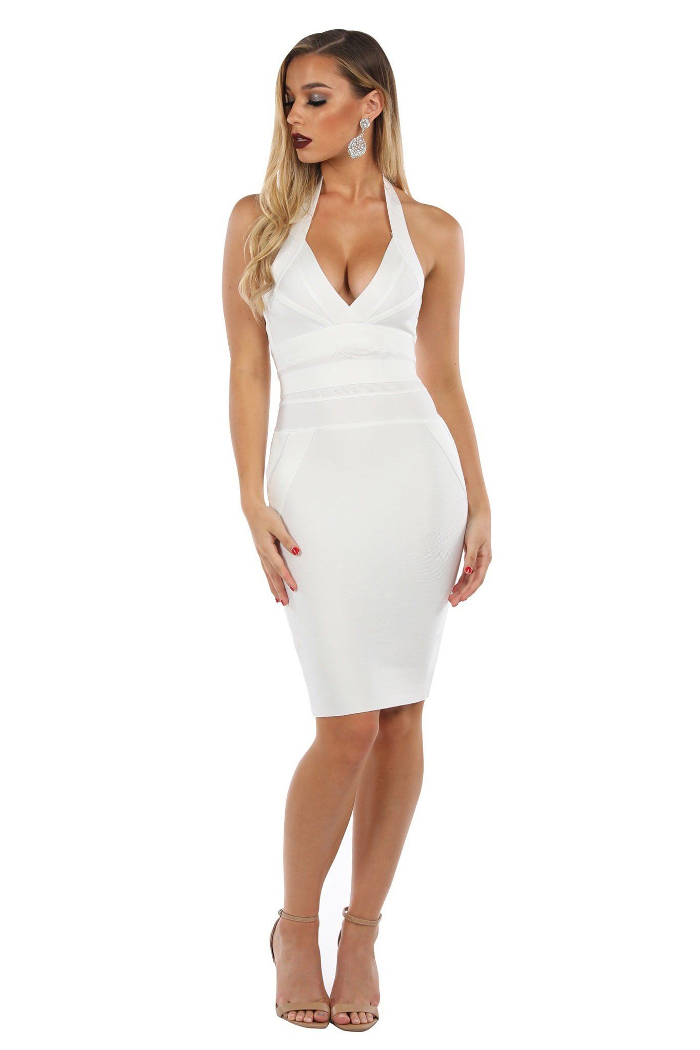 White tight fitting bandage dress in knee length with plunging halter neckline and open back design
