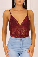 Wine red sleeveless lace bodysuit lined at bust with adjustable shoulder straps