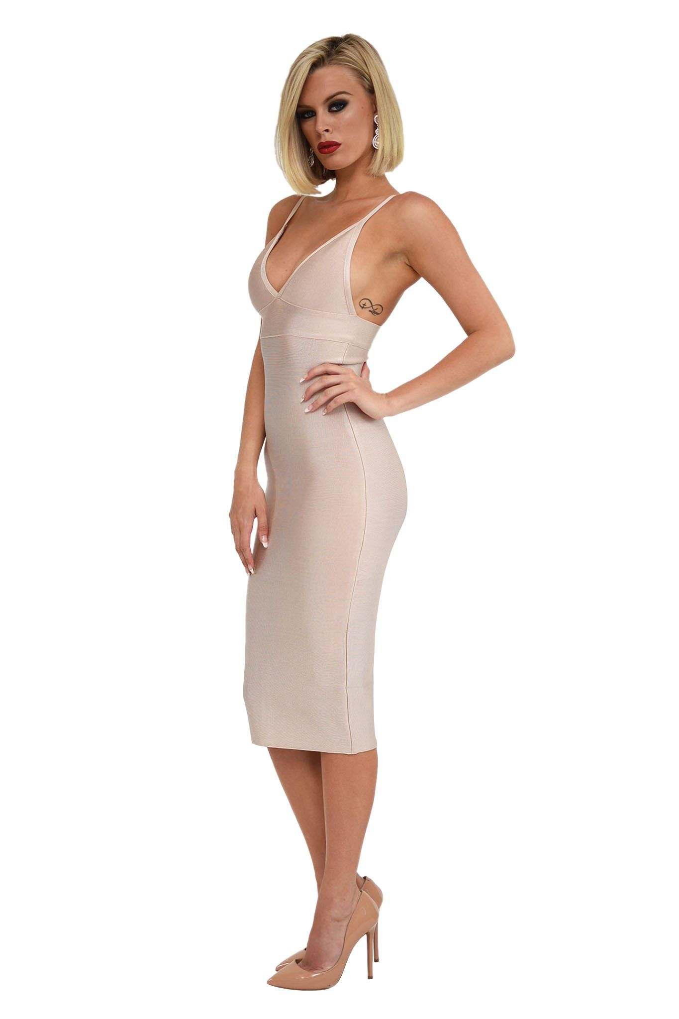 Side shot of nude colored bandage dress midi length bodycon tight fitted deep v neck spaghetti straps
