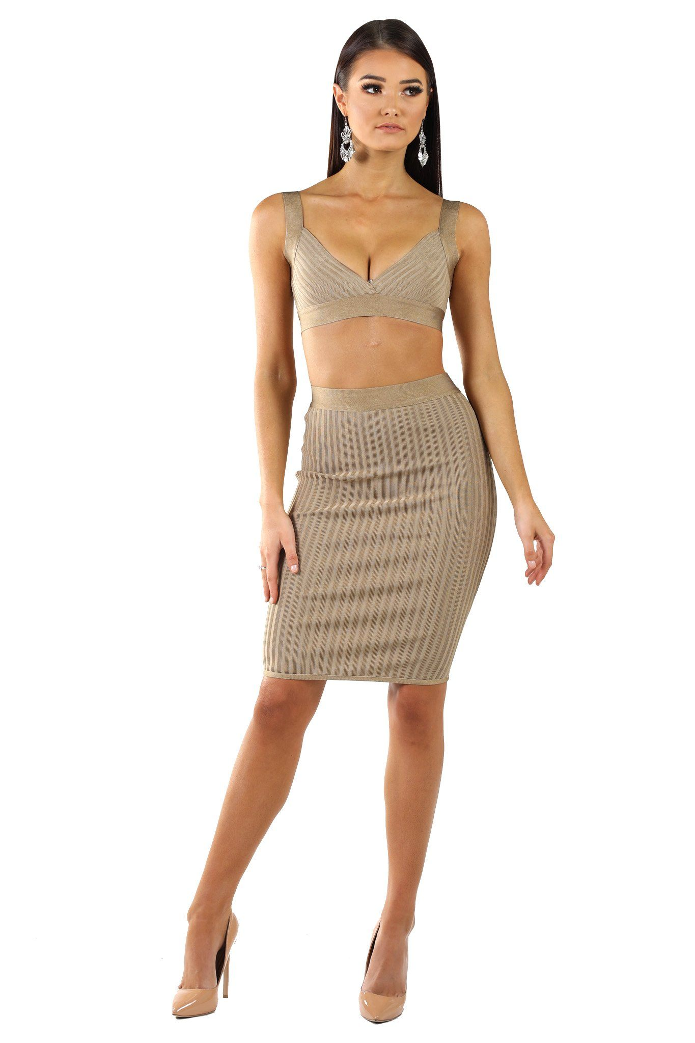 Two-piece matching set including bralette-style top and knee-length pencil skirt both made from stretchy lightweight ribbed bandage fabric in light brown colour
