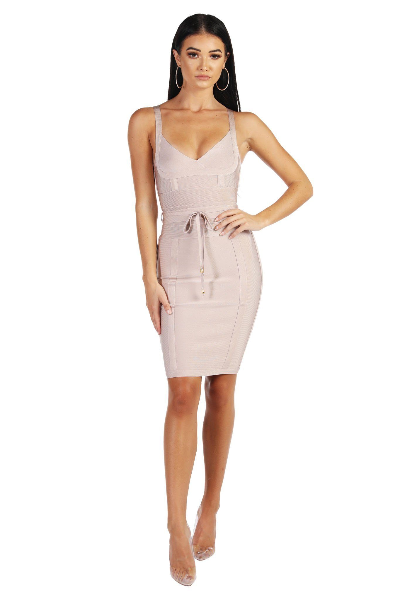 Nude colored mini sleeveless bandage dress with thin shoulder straps, thin removable belt, and full-length back zipper