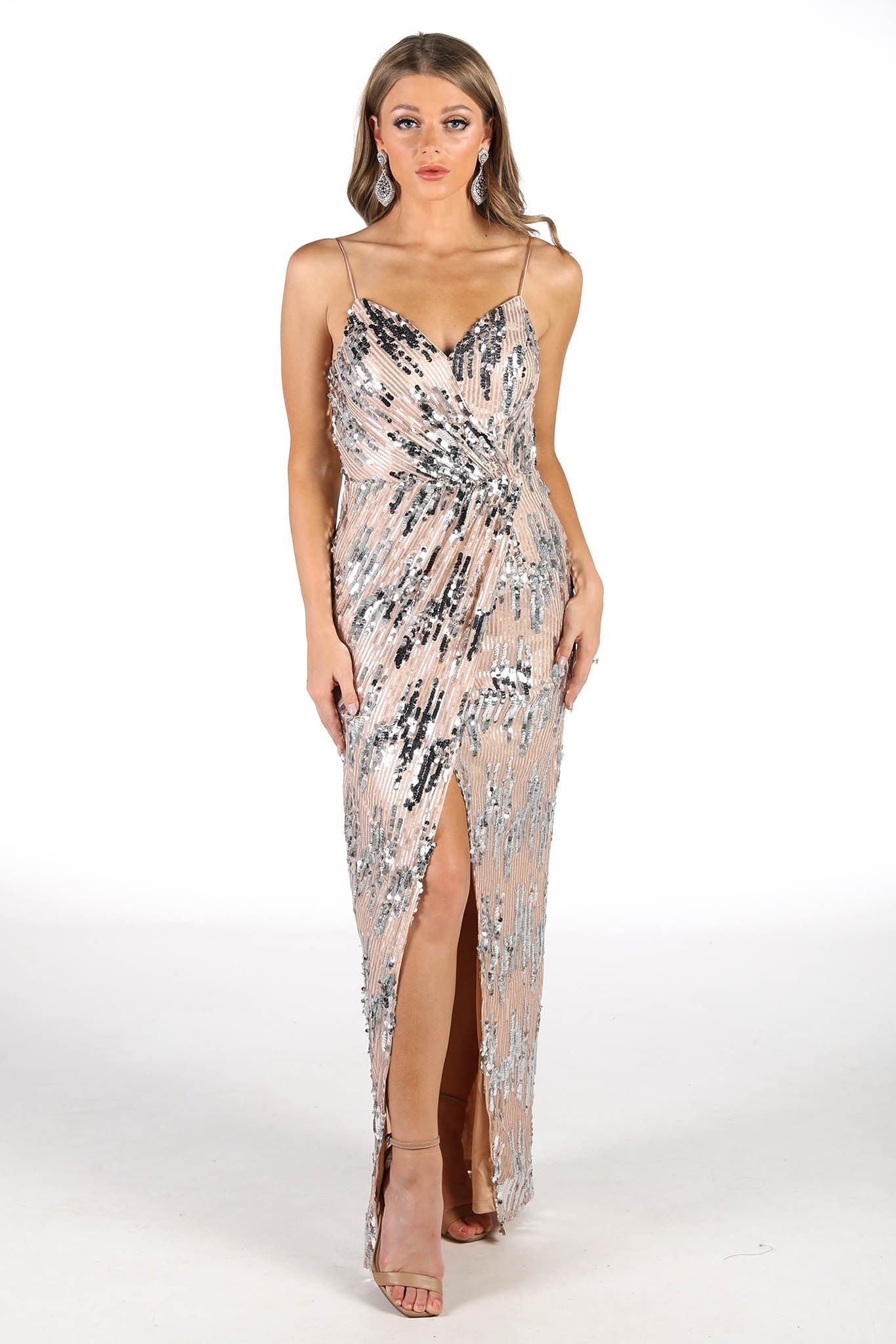 Champagne/Silver sequin maxi dress with V neckline, thin shoulder straps, faux wrap design, front split and column maxi silhouette