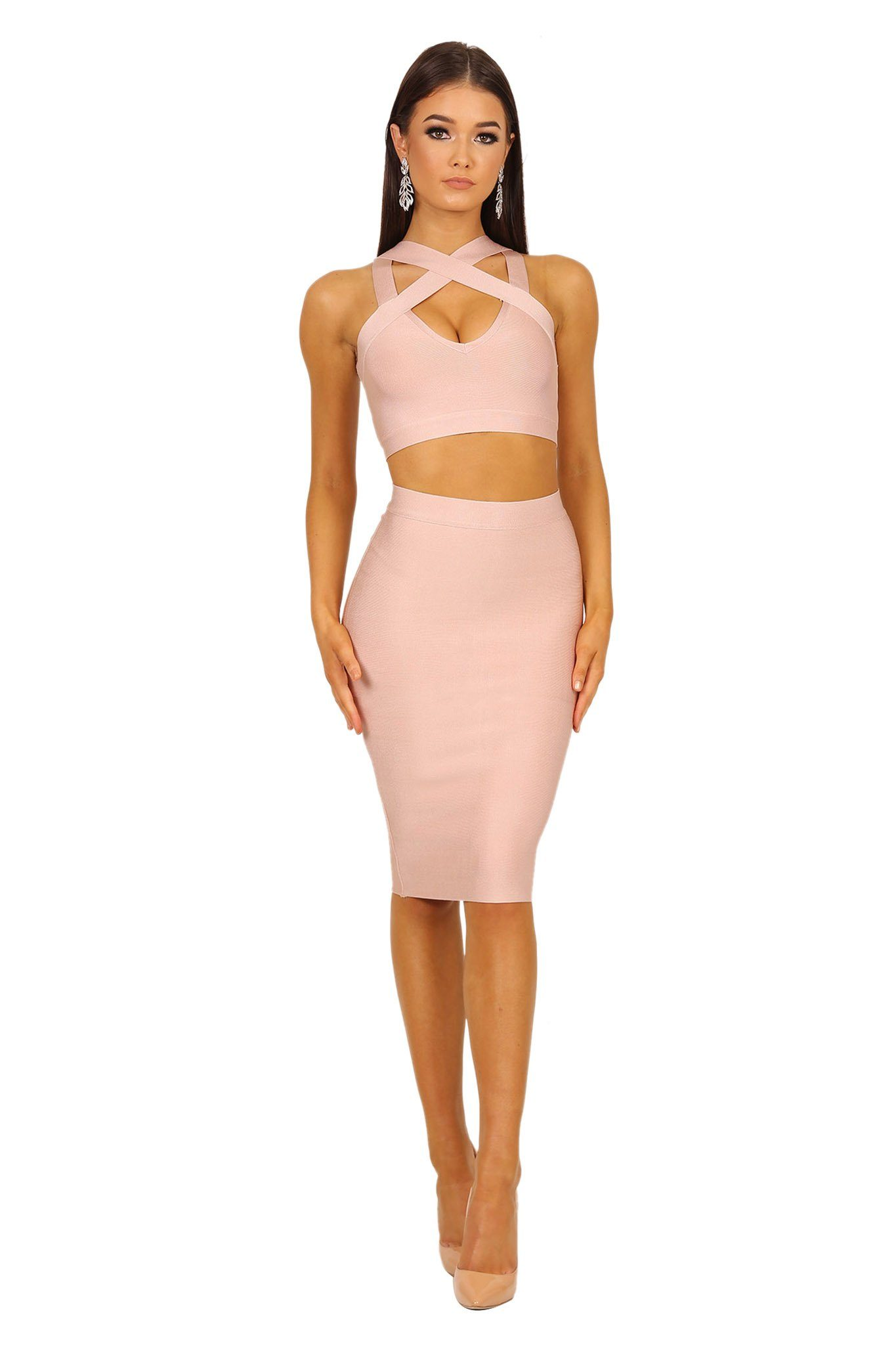 Two-piece bandage set in light pink color including a bandage crop top with peephole at bust and a midi length bandage pencil skirt