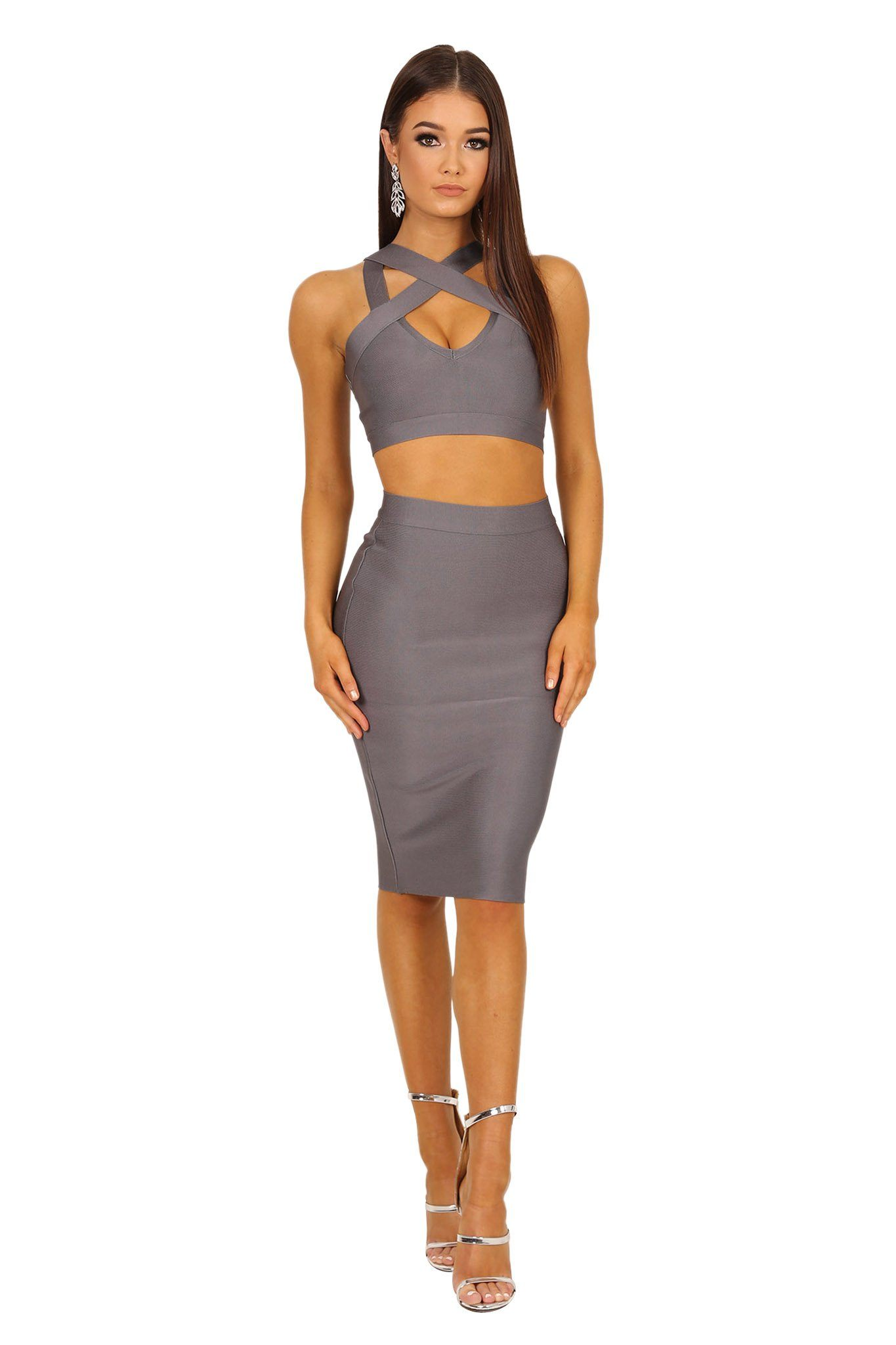 Two-piece bandage set in grey color including a bandage crop top with peephole at bust and a midi length bandage pencil skirt