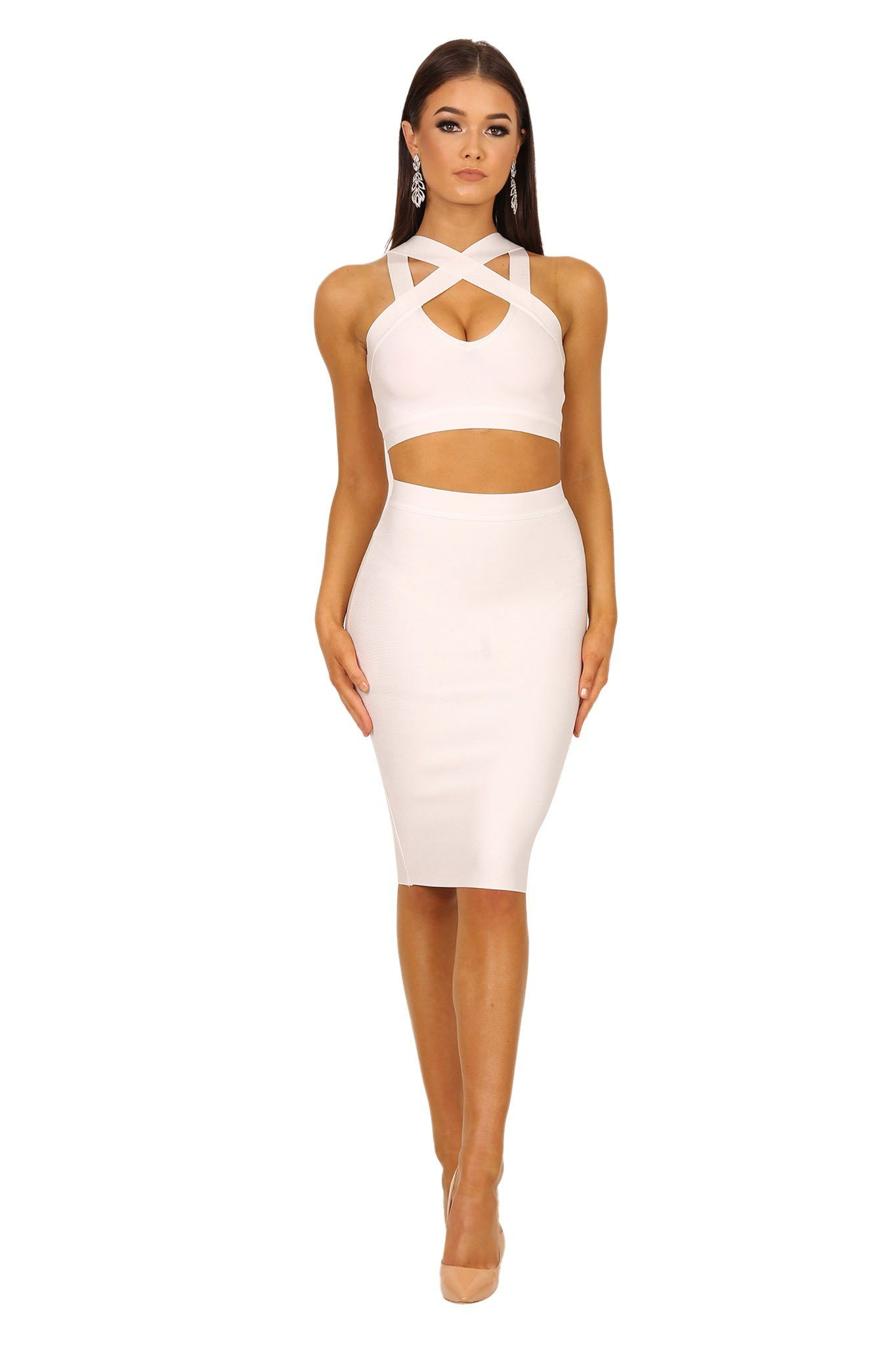 Two-piece bandage set in white color including a bandage crop top with peephole at bust and a midi length bandage pencil skirt