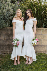White maxi length bridesmaid dress with off-shoulder sweetheart neckline and high low fishtail hem