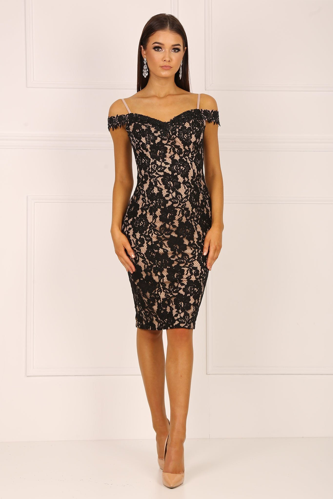 Black knee length form fitted lace dress with beige underlay featuring off the shoulder design and sweetheart neckline
