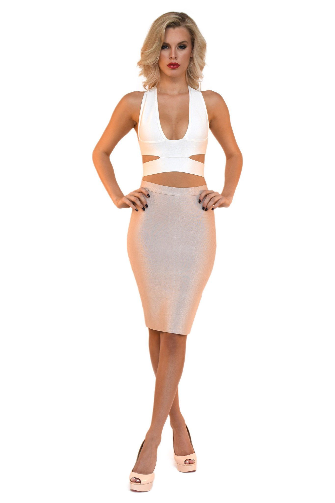 Front of two piece bandage set including white cutout plunging neck crop top and nude colored midi pencil skirt