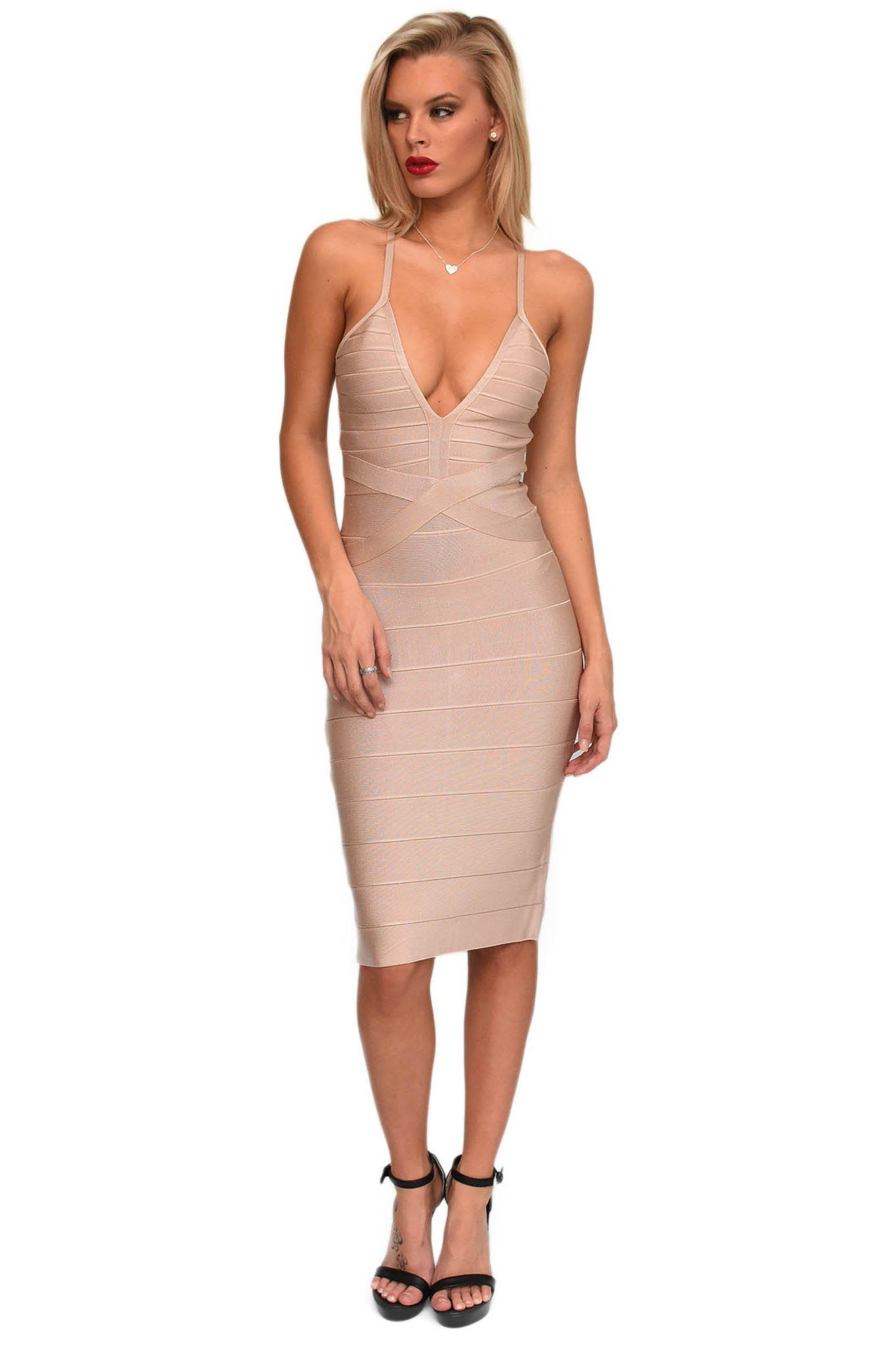 Nude coloured knee-length stretchy bandage dress with back crisscross thin straps and V plunging neckline