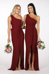 Bridesmaids in Deep Red Wine Coloured Nelia One Shoulder Maxi Dress with Asymmetrical One Shoulder Neckline, Ruched Waist, Above Knee Slit, and a Column Styled Silhouette