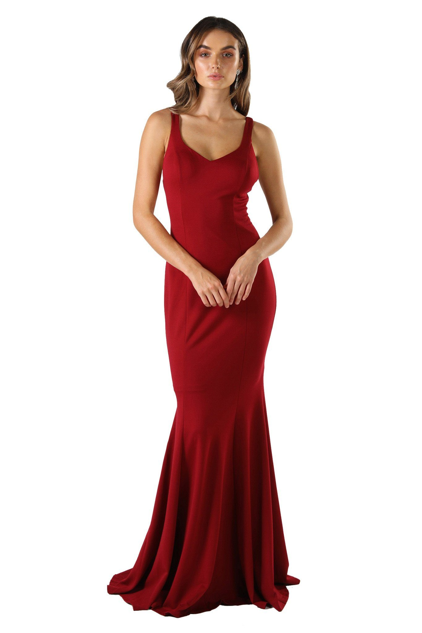 Wine red coloured sleeveless form fitting formal maxi dress featuring subtle sweetheart neckline, shoulder straps, mermaid fishtail and open back design