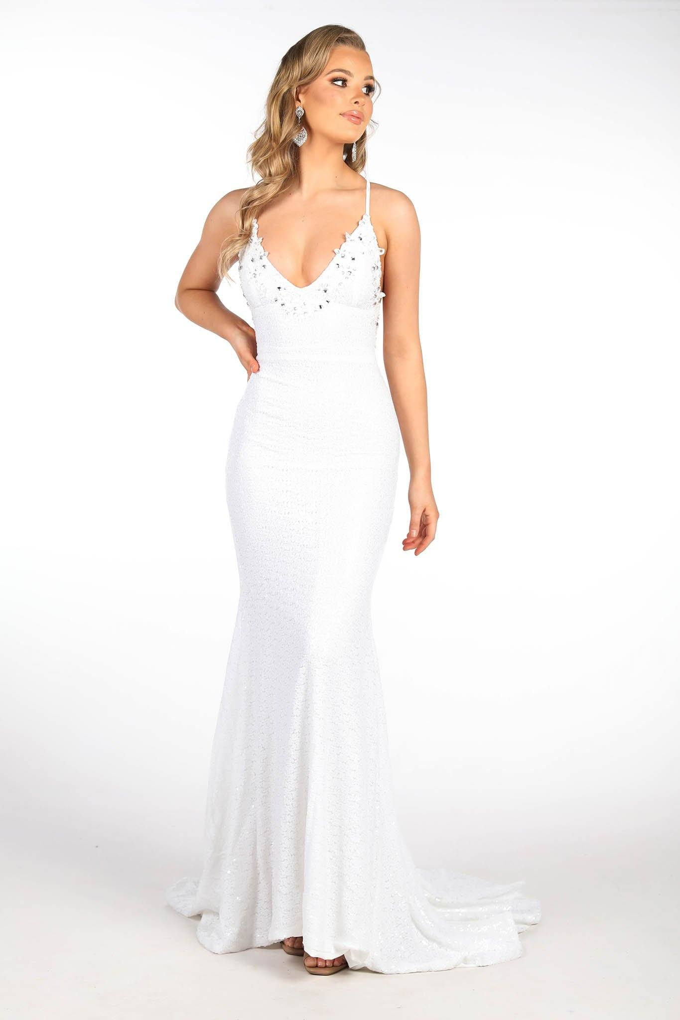 White full length sequin gown featuring hand beaded lace detail, V plunging neckline, thin straps with lace up on open back and sweep train