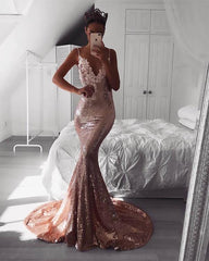 Instagram Blogger Emma Spiliopoulos wearing Roselle Luxe in Rose Gold sleeveless fitted sequin evening long gown featuring V neckline with beaded lace detailing, thin shoulder straps, V backless design and very long train