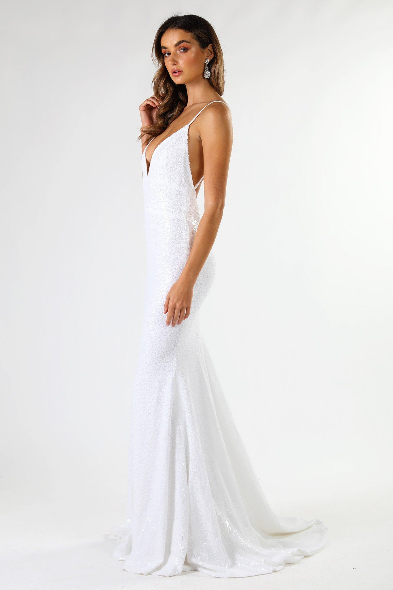 ... Side shot of fitted white sequin formal wedding sleeveless long gown  featuring deep V neck aadf336f4