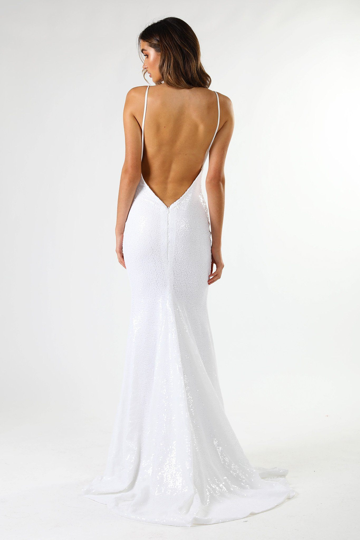 ... V Shaped Backless Design of Fitted White Sequin Formal Wedding  Sleeveless Gown featuring Deep V Neck cc76b0554