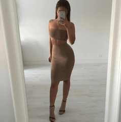 Nicole Khalil wearing khaki brown two piece bandage set including a bandeau top and midi pencil skirt
