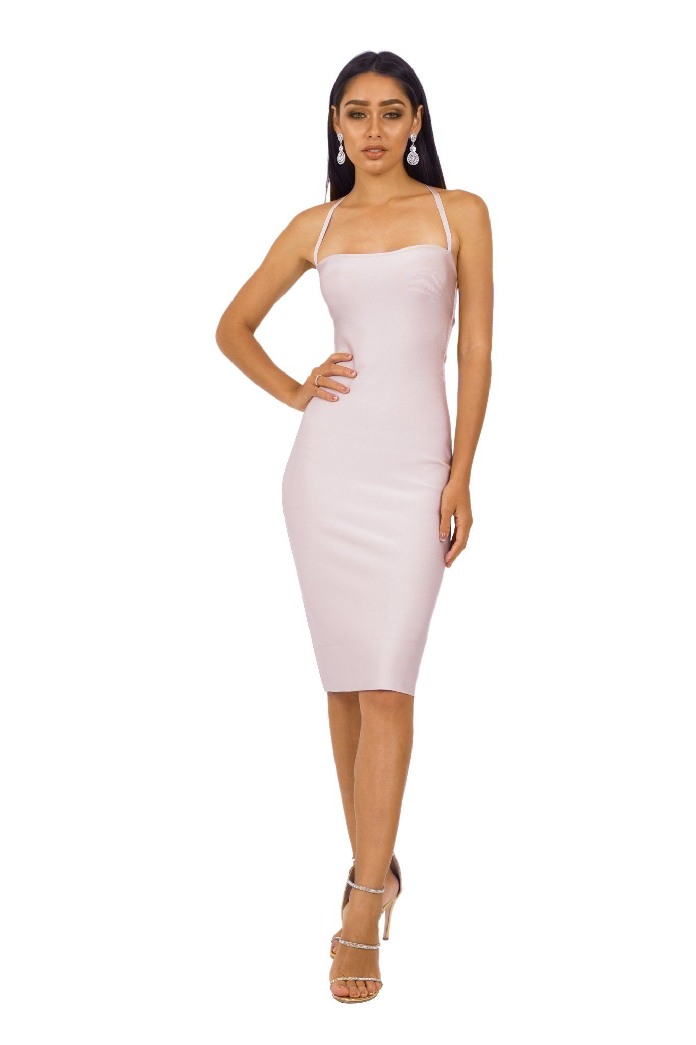 Nude colored knee length bodycon bandage dress with square neckline and lace-up back design