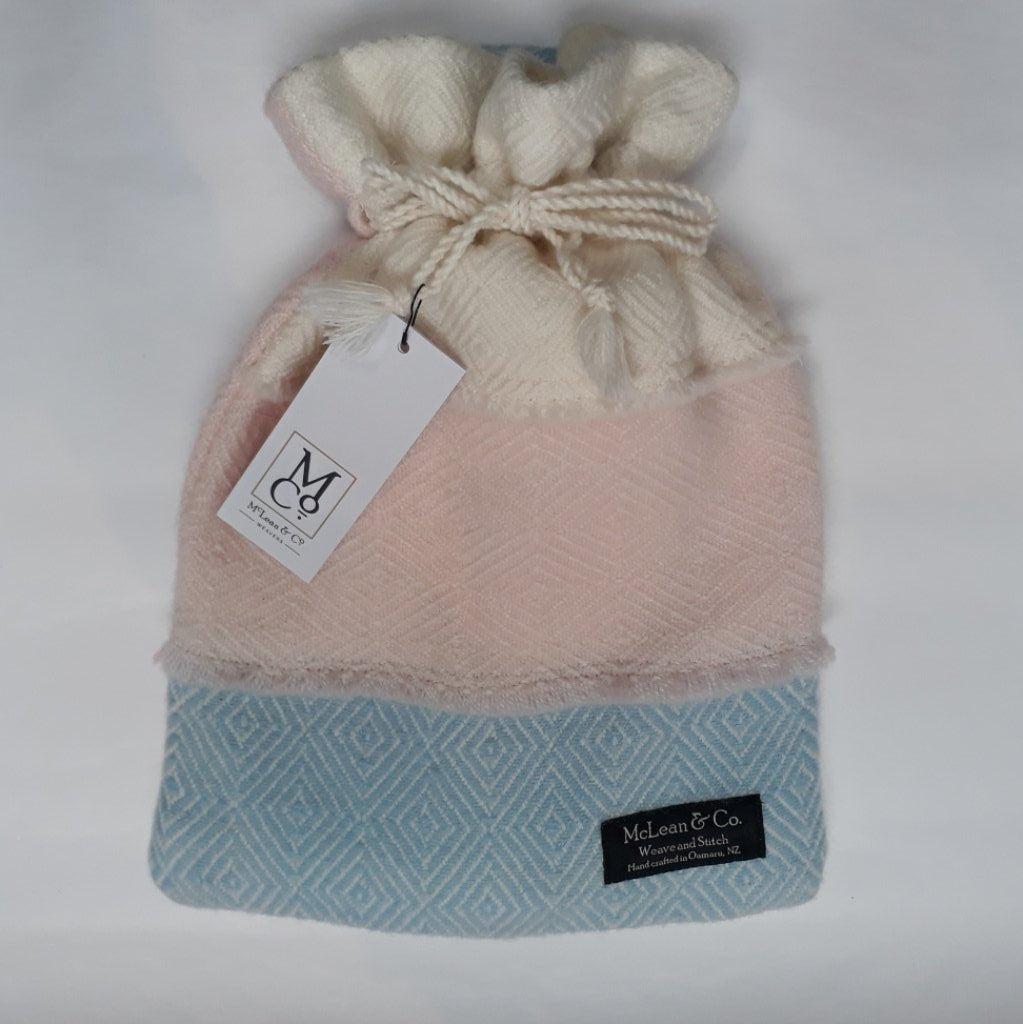 Pink, blue and white hot water bottle cover - with small Fashy hot water bottle