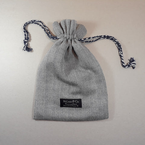 Grey and white herringbone hot water bottle cover - with small Fashy hot water bottle