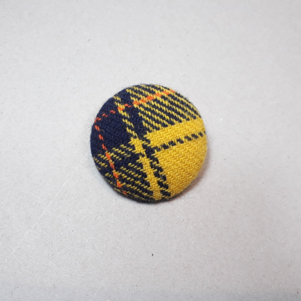 Gold, navy and orange tartan brooch