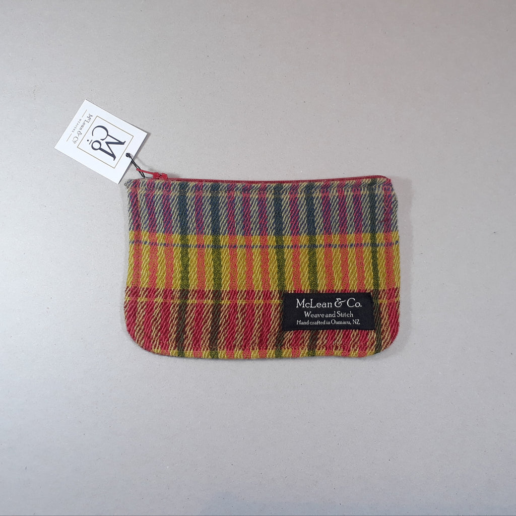 Colourful checked and striped purse