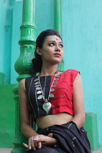 Black and red panel sleeveless blouse.