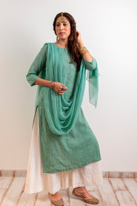 Straight kurta in Mul with a boat neck, detailed with potli buttons