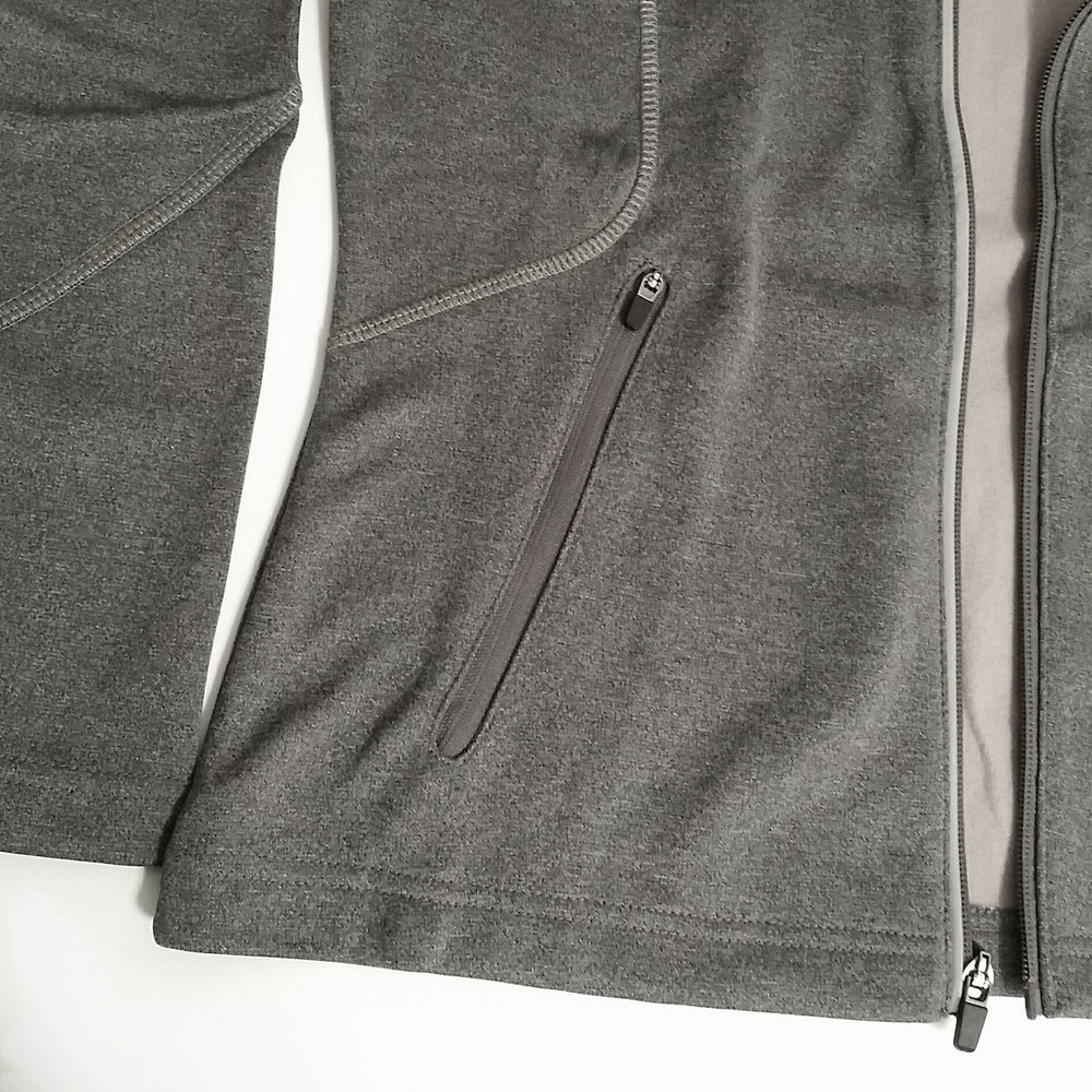 Performance jacket close up of pocket from Ontario Northland, colour greyish.