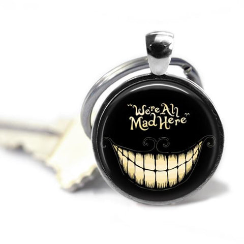 Alice In Wonderland's Cheshire Cat Key chain We're All Mad Here