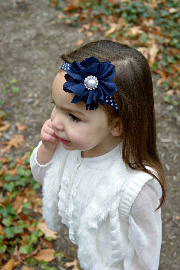 Penelope- Navy flower with pearl on a polka dot headband