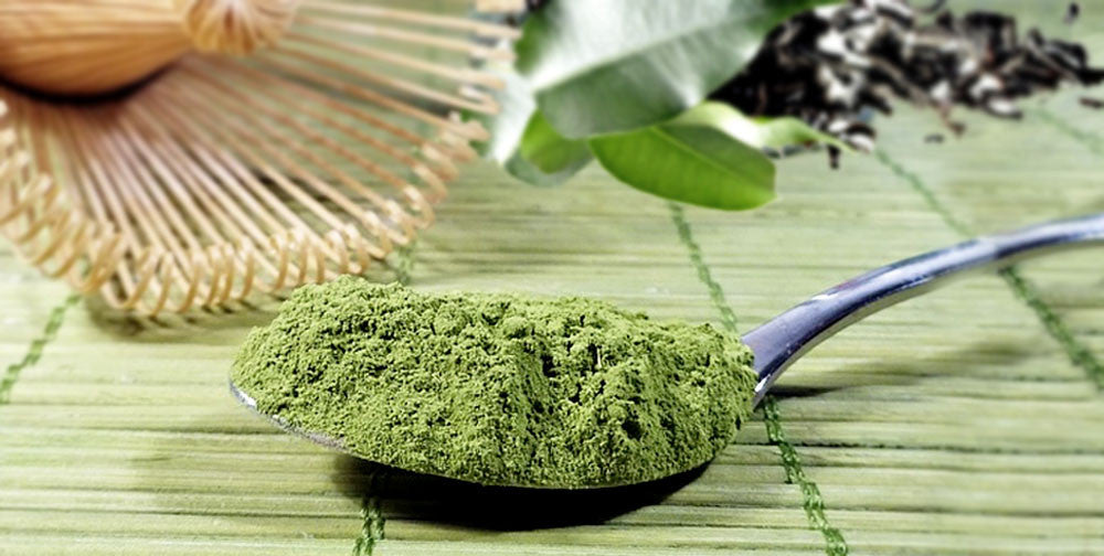 photo of matcha green tea in teaspoon