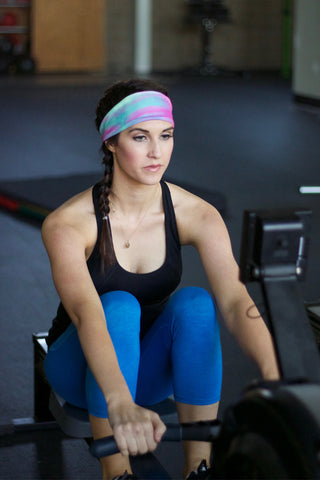 Fitness model rowing with lake powell sunset fitness headband