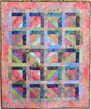 Original strip pieced quilt in pink, green, blue and purple.