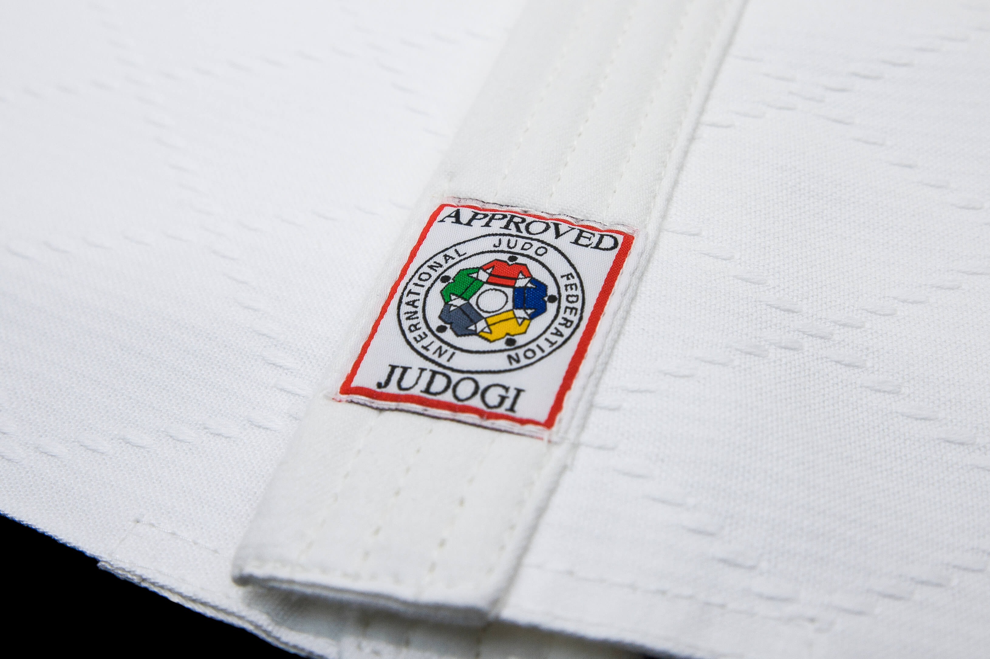 Mandatory red label on a white Judogi