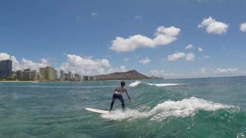 Jocelyn Lu surfing in Hawaii