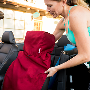 Putting on Dryasana Car Seat Cover
