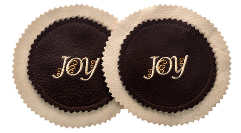 This set of two Zelenco beige and dark brown waterproof leather coasters make great holiday or personal gifts.