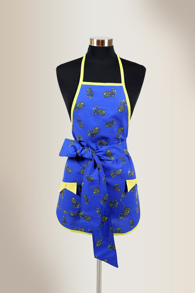 Blue apron with pineaple print and yellow trim.