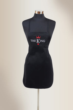 "Black apron with embroidered design ""The King"""