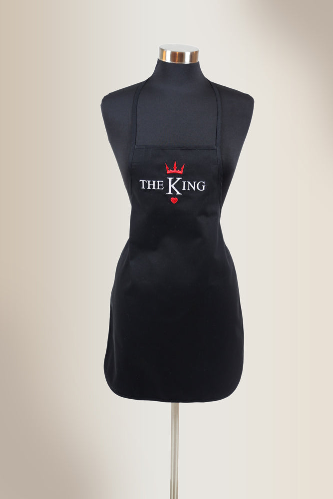Black apron with embroidered design