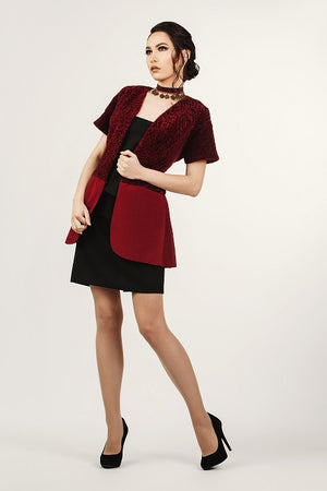 For a slightly warmer winter night, impress your loved one wearing a lovely burgundy lambskin jacket, strapless black top, short black skirt.