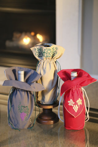 Zelenco's colorful wine gift bag set. Three different colors embroidered in three unique ways.  Enjoy these with fine wine or as dinner table decorations.