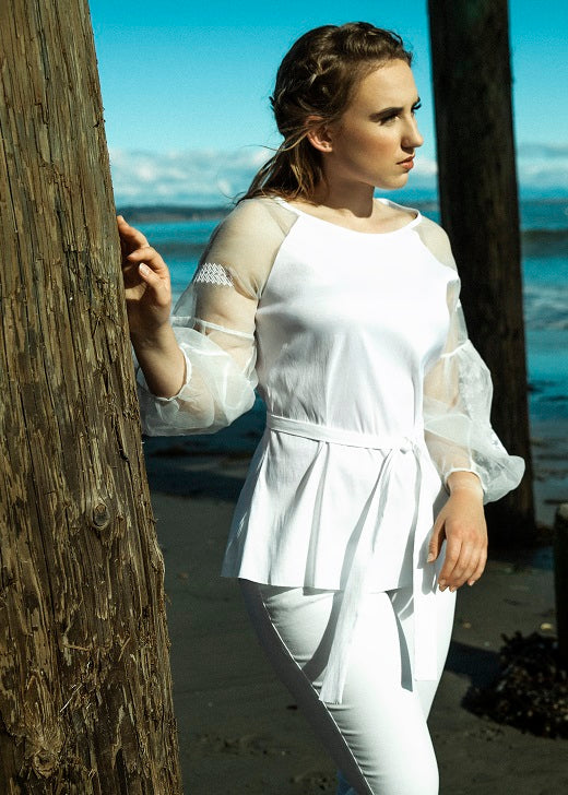 White poly main part of blouse with see thru organza embroidered sleeves. Fabric belt included.  Dry clean recomended.