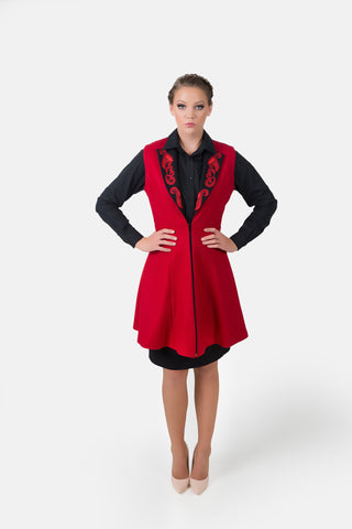 Stylish women's red vest made from fine wool with Zelenco's own embroidered designs outlining the open front.  Comfortable yet modern.