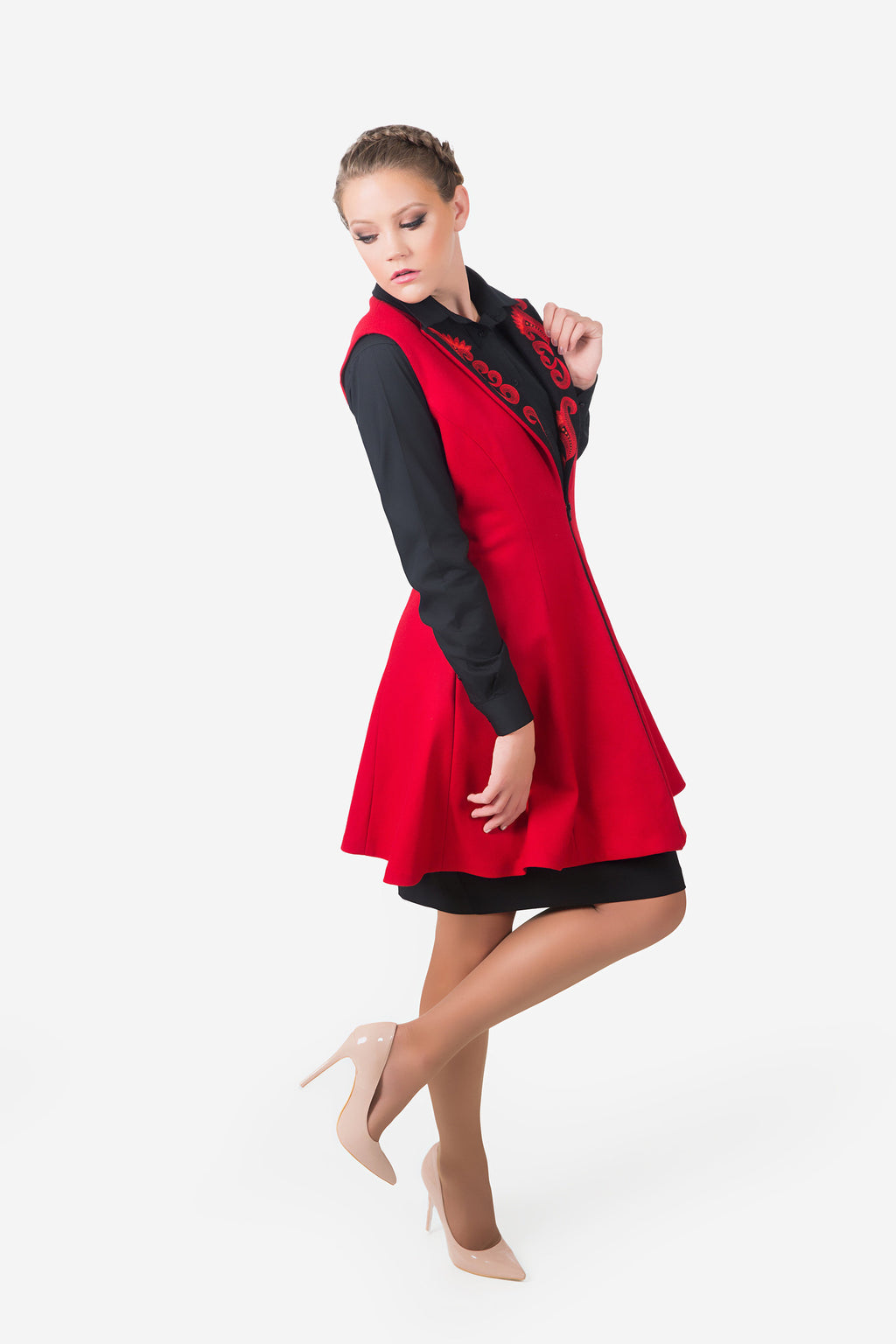 Stylish women's red vest made from fine wool. Side view displaying the accented front opening.  Comfortable yet modern.