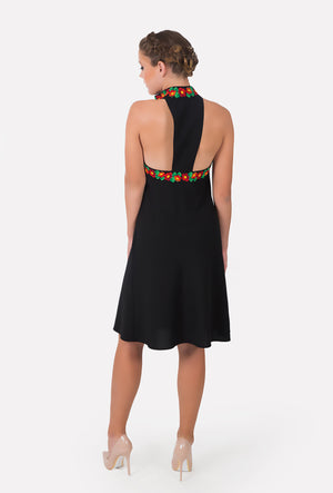 Back view of mid-length black cocktail dress.  Cool during summer parties.
