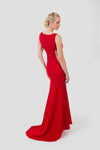 Elegant red evening dress with open neck and sides. A small train has been added.
